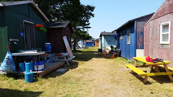 The colorful cabins of nearby Chapel Island, Nova Scotia.
