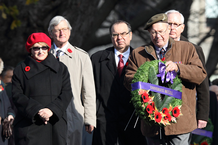 Veteran and McGill alum Tex Dawson (holding wreath) accompanies Principal Suzanne Fortier; Michael A. Meighen, Chancellor; Michael Di Grappa, Vice-Principal (Administration and Finance); and Kip Cobbett, Chairman of McGill's Board of Governors to the cenotaph. / Photo: Owen Egan