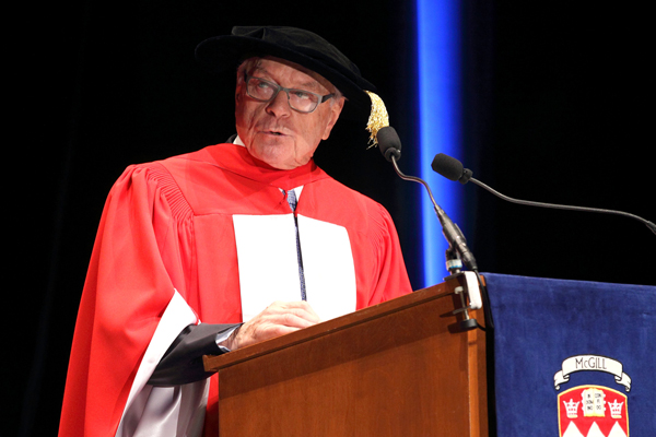 """""""If we don't invest in human interaction, we may find ourselves in a world that is a little less clear, a little less compelling, and a little less cohesive,"""" Marvin Corber told the graduating Class of 2014. / Photo: Owen Egan"""