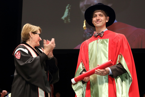Gary Brouhard receiving the prize in the Assistant Professor category. / Photo: Owen Egan