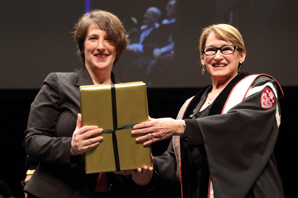 Melissa Knock, manager of educational services in the Faculty of Medicine, accepts the  Principal's Awards for Administrative and Support Staff from Suzanne Fortier. / Photo: Owen Egan