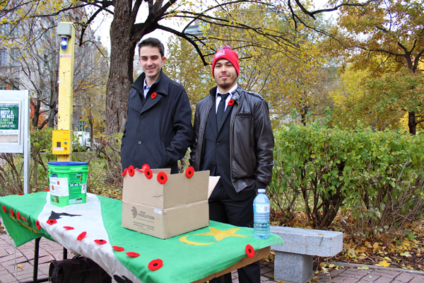 Alexandre Laramée (left) and Ryan Lee of the Memorial Chapter of the Alpha Delta Phi fraternity selling poppies at the Y intersection. / Photo: Neale McDevitt