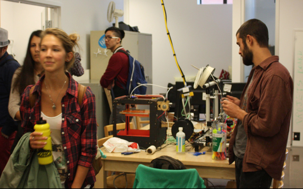 Students exploring ÉchoFab, the first fab lab in Montreal, during the QI tour as part of Community Engagement Day 2014 / Photo: Sylvia Moffatt