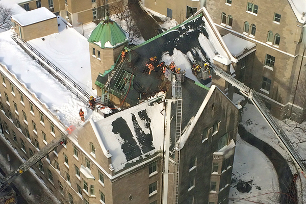 Montreal firefighters on the roof of Royal Victoria College. The fire was quickly extinguished and there were no injuries. / Photo: Dan O'Connell