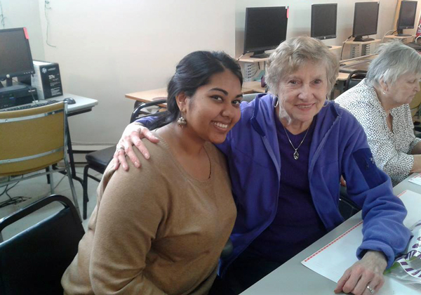 Shivana Mohammed with a participant at the St-Antoine 50+ Centre. / Photo: Jennifer Yang.