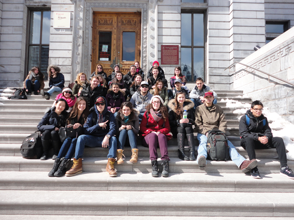 Students from the Kahnawake Survival School  take a break on the steps of the Arts Building. / Photo: Allan Vicaire