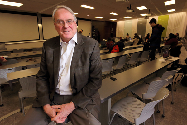 Each Thursday, Ken Dryden leads a class for 140 students across four time zones. / Photo: Owen Egan