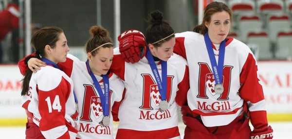 Dejected members of the McGill Martlets following the team's 5-0 loss to Western at the CIS women's hockey championships. / Photo: David Moll, courtesy of the University of Calgary.