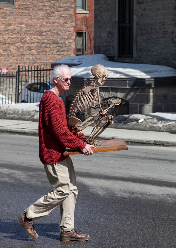 Richard Fraser, Director of the MAude Abbott Medical Museum, carries a skeleton to its new home in the Strathcona Anatomy and Dentistry Building. / Photo: Joan O'Malley