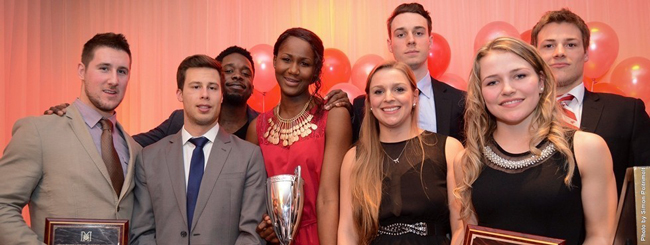 McGill's major trophy recipients (L to R): Benoit Levesque (Pound Trophy), Cedric McNicoll (Forbes Trophy), Jonathan Telfort (Teskey Award), Mariam Sylla (Bean Trophy), Valerie De Broux (Roscoe Trophy), Francois Bourque (Auders Award), Marika Guerin (top female rookie) and Karl Forgues (top male rookie). / Photo: Simon Poitrimolt