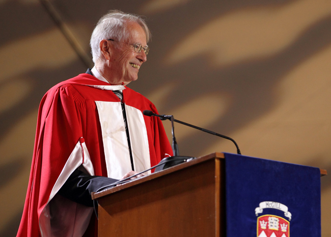 The Honourable René Dussault addresses the audience during the Continuing Studies ceremony. / Photo: Owen Egan