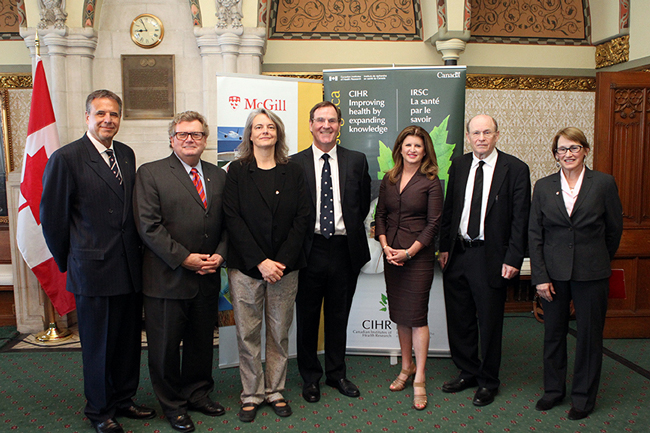 (l-r) Alain Beaudet, President, CIHR; Ed Holder, Minister of State (Science and Technology); Prof. Brigitte Kieffer; Prof. Alan Evans; Rona Ambrose, Minister of Health; Prof. Nahum Sonenberg; Prof. Suzanne Fortier. / Photo: House of Commons photographer