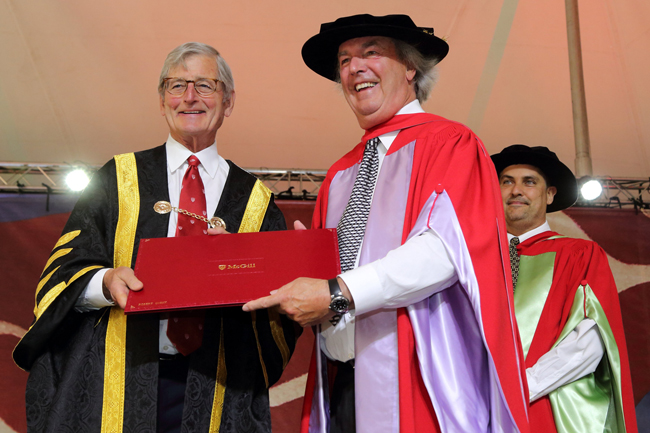 Robert Godin accepts his Honorary Degree from Chancellor Michael A. Meighen. / Photo: Owen Egan
