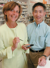 Robyn Tamblyn and Allen Huang in the St. Charles Boulevard Pharmaprix, one of the Montreal-area drugstores participating in the MOXXI project