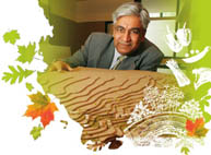 Urban planning professor Vikram Bhatt with a topographical model of an area outside of Kampala, Uganda, where he is working with the local government to plan a new settlement that will incorporate urban agriculture