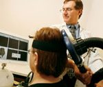 Dr. Howard Chertkow performs transcranial magnetic stimulation (TMS), a non-invasive procedure that stimulates brain activity. Chertkow's research explores the therapeutic potential of TMS in treating Alzheimer's disease.