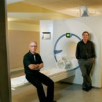 To construct a map of the average human brain, Bruce Pike (left), Alan Evans and their team captures hundreds of individual images using MRI equipment.