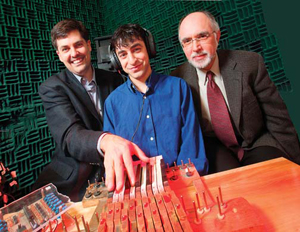 Avrum Hollinger (middle), a graduate student in Marcelo Wanderley's (left) electrical engineering lab, built a metal-free keyboard that can be played inside a highly magnetic MRI machine. The special instrument now makes it possible for neuroscientist Robert Zatorre (right) to monitor musicians' brain activity while they play.