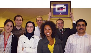 Dr. Janusz Rak (holding plaque) shared the Québec Science honour with his research team (from left): Delphine Garnier, postdoctoral fellow; Alexander Dombrovsky, graduate student; Maryam Hashemi, undergraduate student; Brian Meehan, research assistant; Nathalie Magnus, graduate student; and Khalid Al-Nedawi, postdoctoral fellow.