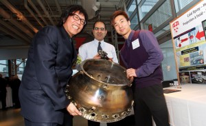 Stephen Yue (left) is the inaugural Lorne Trottier Chair in Aerospace Engineering. Postdoctoral fellow Ahmad Rezaeian (centre) and graduate student Wilson Wong are working with Professor Yue on new ways to manufacture aerospace components, like this jet engine combustion chamber.