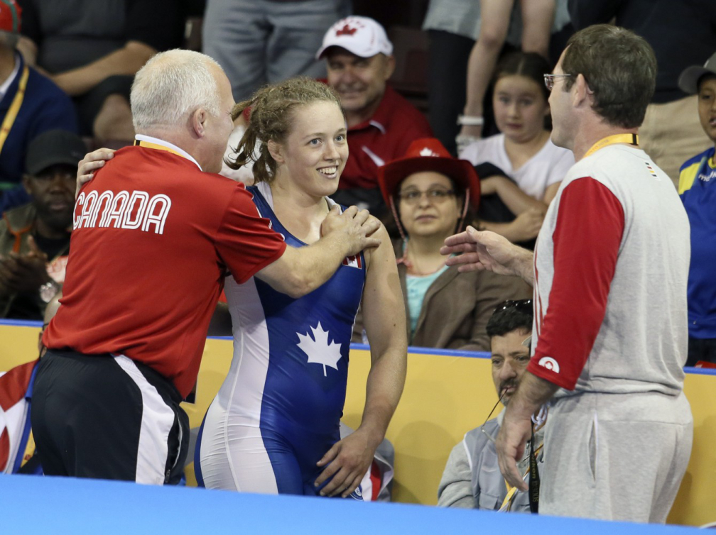 McGill student Dori Yeats celebrates her gold medal win with her father and coach, Doug Yeats (red shirt). / Photo: Mike Ridewood/COC