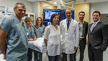 From left to right: Dr. Benoît Gallix; Svetalna Bityutskaya; Maria Renzullo; Zohra Nabbus, patient; Dr. Steven Paraskevas; Marco Gasparrini; and Craig Hasilo. / Photo courtesy Dave Sidaway, The Montreal Gazette