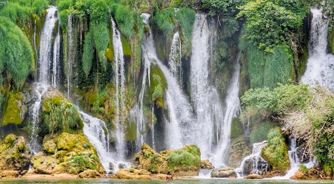 Just having a shower (Kravice Falls, Bosnia) / Photo: Yannick D'Mello