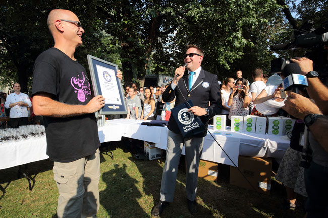 Guinness Word Record adjudicator Michael Empric (right), presents Mathieu Laperle with the official Guinness World Record certificate. / Photo: Owen Egan