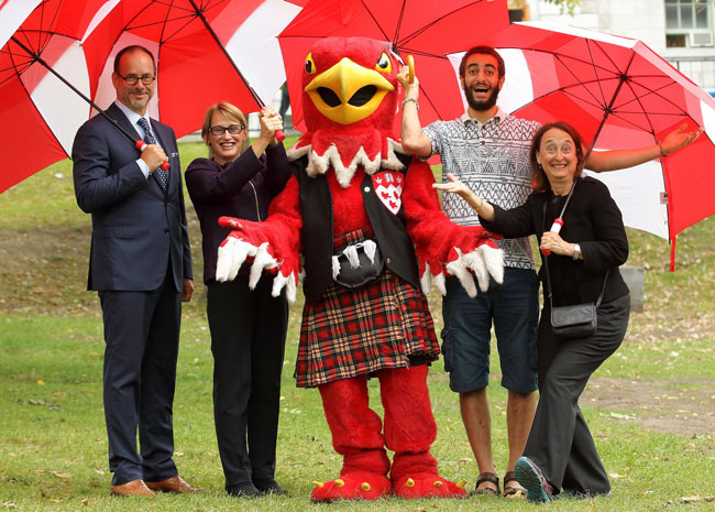 From left to right: Daniel Jutras, Suzanne Fortier, Marty the Martlet, Kareem Ibrahim and Rosie Goldstein gave the 2015 McGill Centraide campaign an enthusiastic kickoff yesterday. / Photo: Owen Egan