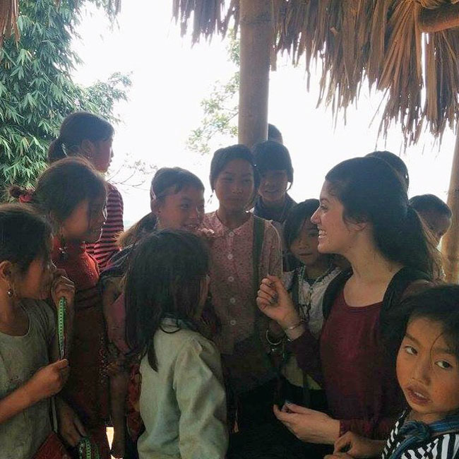 Enrica Ferrarotti helps eager Hmong children practice English in the mountains of Sapa in North Vietnam.