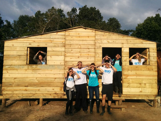 Isabel Engels and the Teto team in front of one of the many houses they built over the summer.