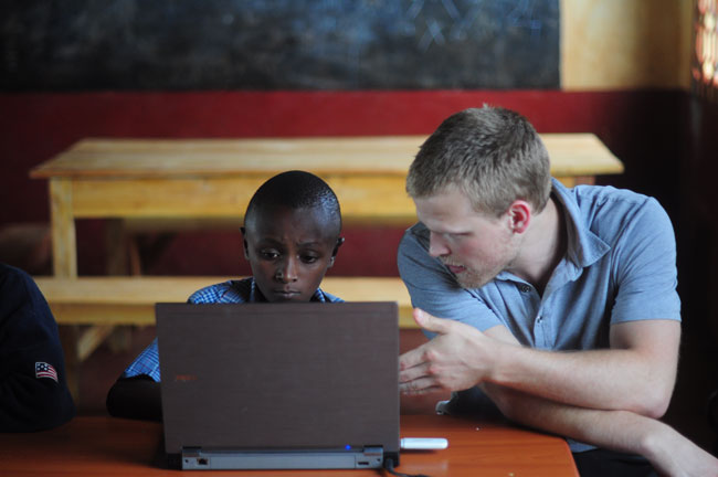 Johnstuart Winchell helps tutor his young charge, Viktor, as part of his internship in Kenya this past summer. / Photo courtesy of Johnstuart Winchell