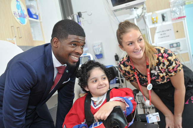 Following his press conference earlier today, Habs defenseman P.K. Subban posed for pictures with six-year-old patient, Jouri, and her nurse. / Photo courtesy of the Montreal Children's Hospital.