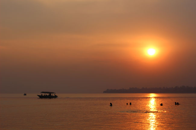 The sun sets over Lake Kivu in Gisenyi. / Photo: Ryan Adessky