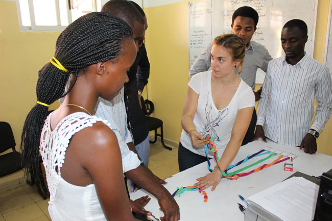 McGill medical student Annie Lalande teaching the brachial plexus to Rwandan medical students with a home-made model.
