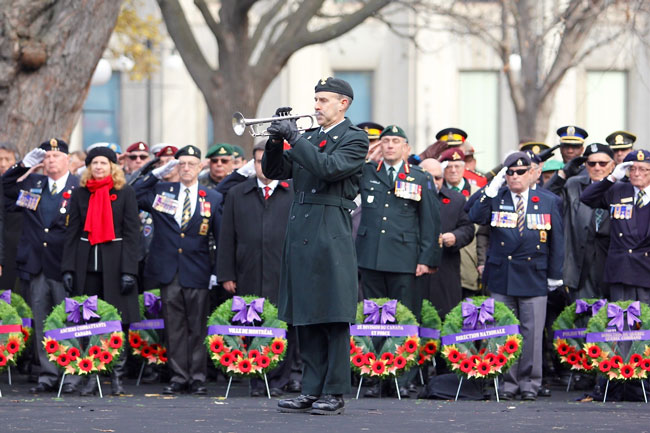 Veterans pay their respects to fallen comrades as Last Post is played during yesterday's Remembrance Day ceremonies on Lower Campus. / Photo: Neale McDevitt