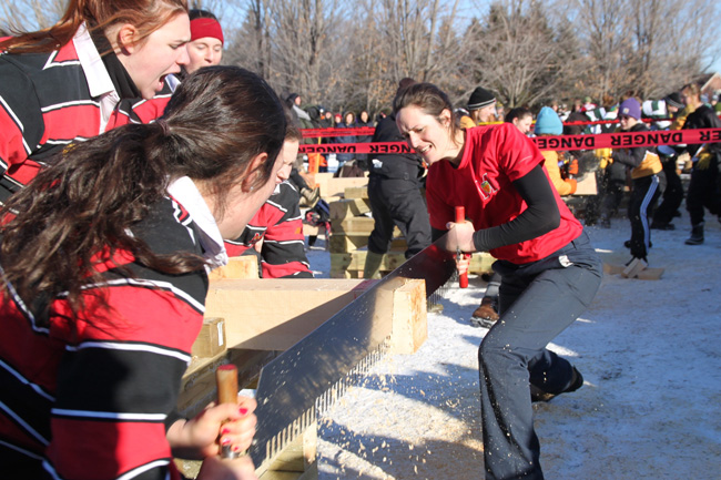 Stephanie Bélanger-Naud  (pictured here in the Crosscut Saw event) helped lead the Mac team to the overall title on Saturday. / Photo: Neale McDevitt
