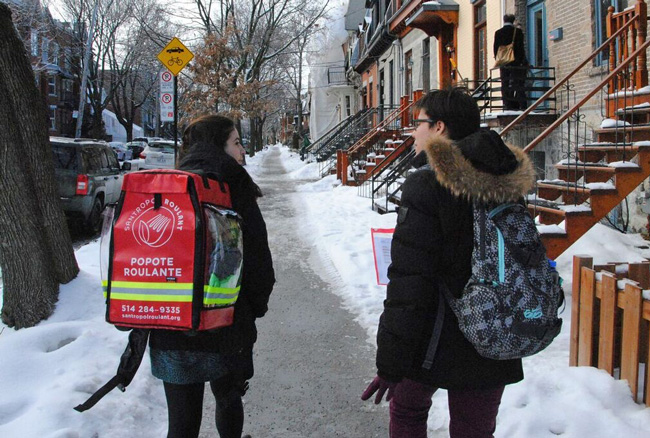 McGill student volunteers working with Santropol Roulant, deliver freshly-prepared meals to the homes of individuals living with a loss of autonomy.