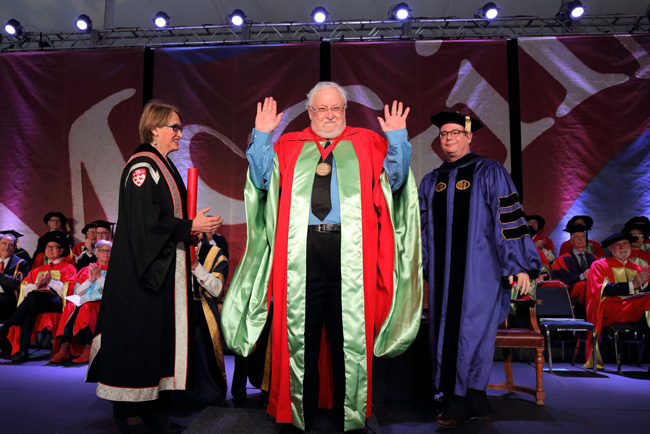 Philip Branton acknowledges the applause after receiving the McGill Medal as part of the Science Convocation ceremony on June 6. / Photo: Owen Egan