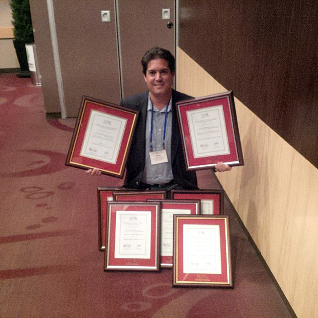 Derek Cassoff, Director of Communications for the Office of University Advancement, poses with McGill's CCAE haul.