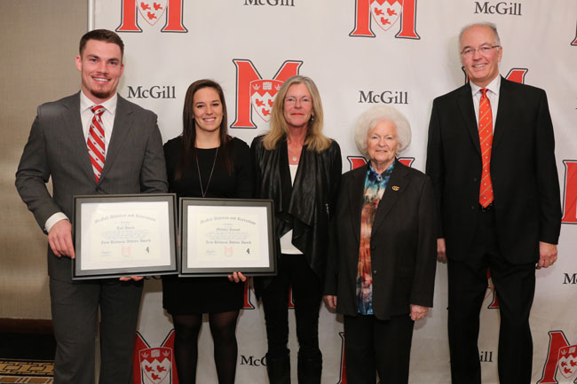 From left to right: Joel Houle and Mélodie Daoust, winners of the inaugural Jean Béliveau Award, with Hélène and Élise Béliveau, and Marc Gélinas, Executive Director of Athletics and Recreation. / Photo: Owen Egan