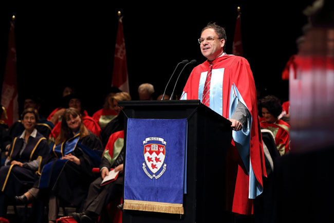 Alumnus Bertrand Cesvet addresses the audience at yesterday's Convocation ceremonies. / Photo: Owen Egan