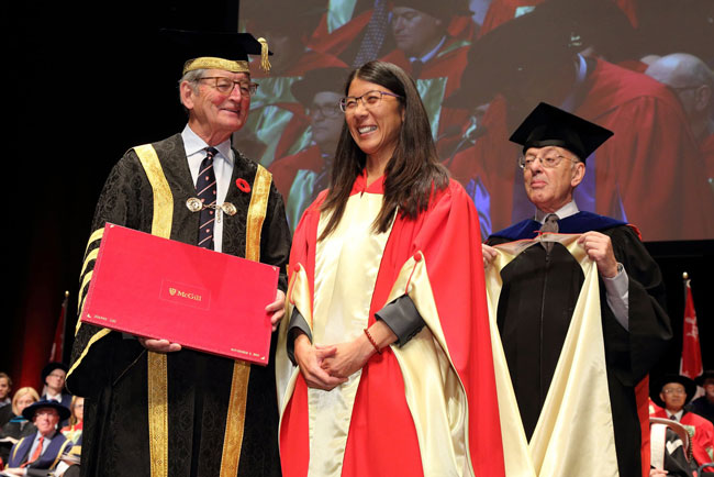 Joanne Liu receives her honorary degree from Chancellor Michael A. Meighen. / Photo: Owen Egan