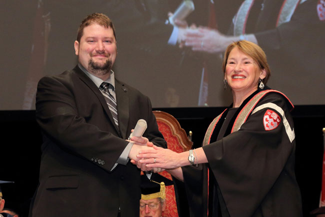 Pascal Pilotte accepts his award in the Trades & Services category from Principal Suzanne Fortier. / Photo: Owen Egan