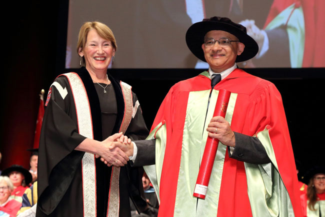 Principal Suzanne Fortier congratulates Prakash Panangaden, winner of the Principal's Prize for Excellence in Teaching in the Full Professor category. / Photo: Owen Egan