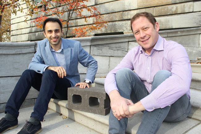 Mehrdad Mahoutian (left) and Chris Stern, with one of their cement-free, carbon-negative concrete blocks. / Photo: Vincent Allaire