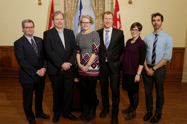 L to r: Christopher Manfredi, Provost; Alexander Theil; Audrey Moores, Mark Miller, MP for Ville‑Marie–Le Sud-Ouest–Île-des-Soeurs; Olivia Wilkins; and Tony Mittermaier at today's announcement. / Photo: Owen Egan