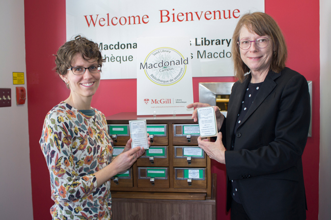 Dana Ingalls, Liaison Librarian at Mac (left), and Colleen Cook, Dean of Libraries at the March 20 launch of the seed library. / Photo: Lauren Goldman