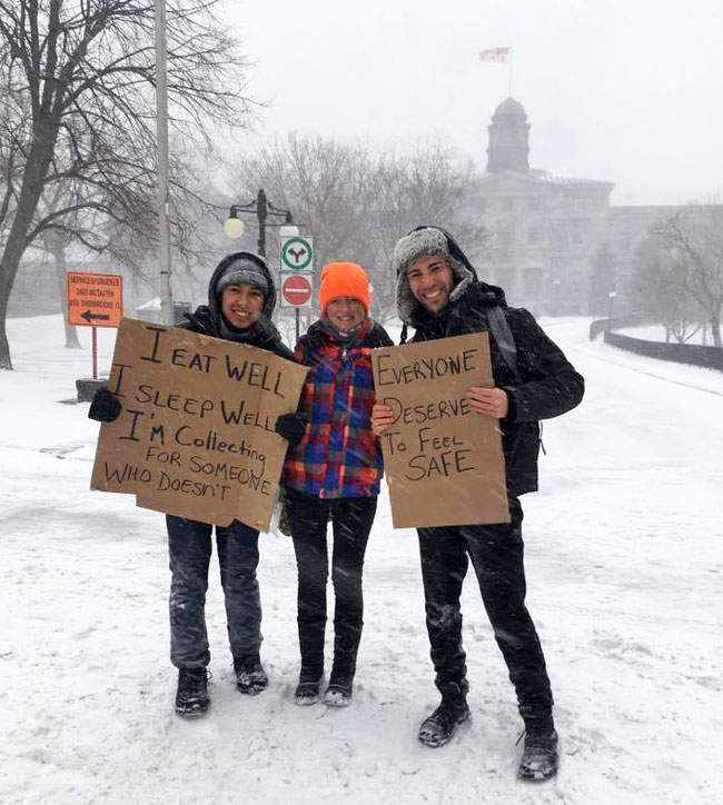 From left to right: McGill students Daniel Chiu, Meghan Bottomley and Sebastien Herman do their part for Five Days for the Homeless on March 15, just at the beginning of the massive snowstorm that hit Montreal.