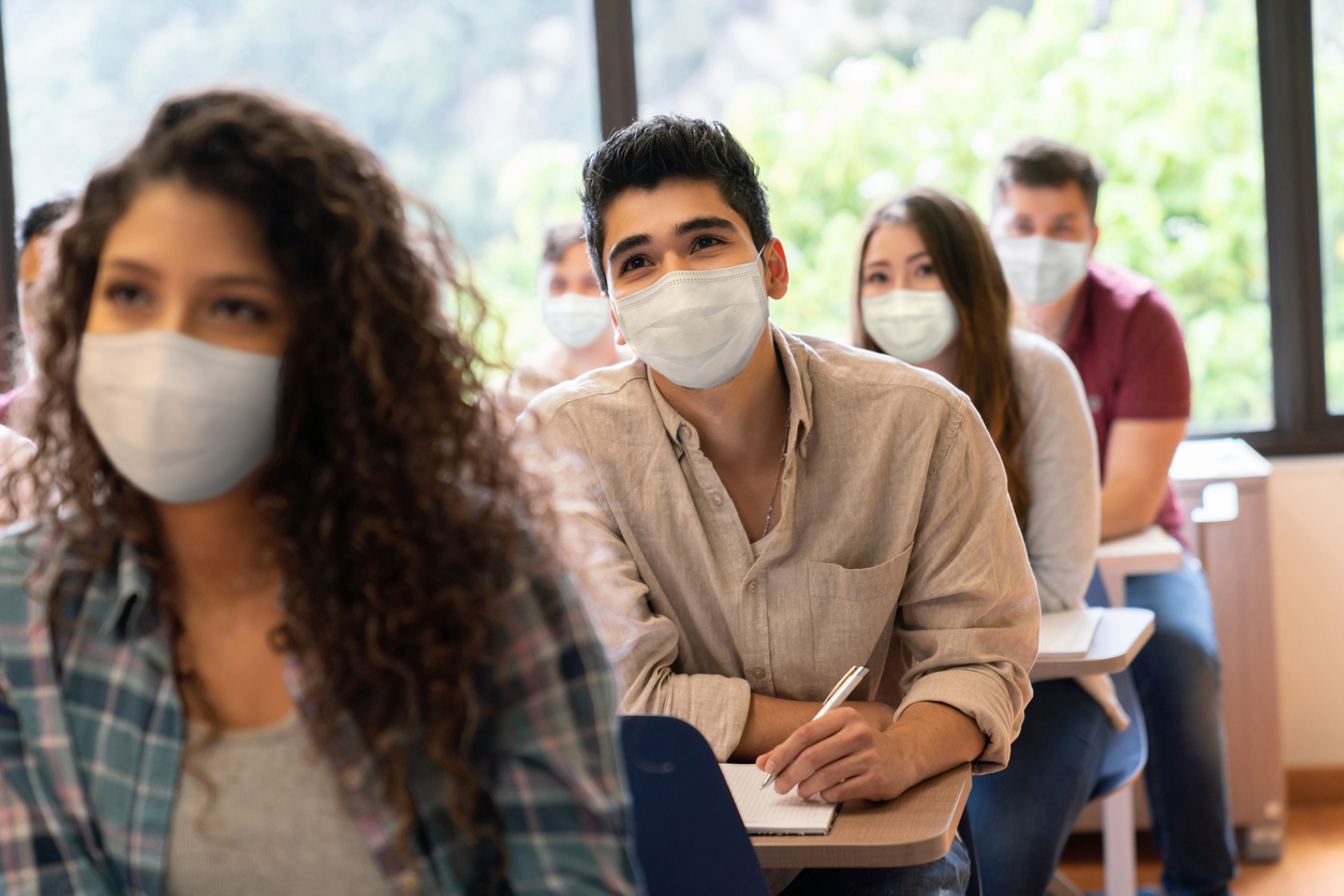 Stock photo of masked students in classroom